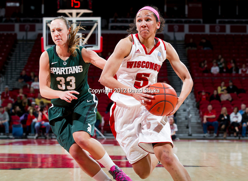 Wisconsin Badgers guard Morgan Paige (5) handles the ball during a Big Ten Conference NCAA college women's basketball game against the Michigan State Spartans on Thursday, February 16, 2012 in Madison, Wisconsin. Michigan State won 62-46. (Photo by David Stluka)