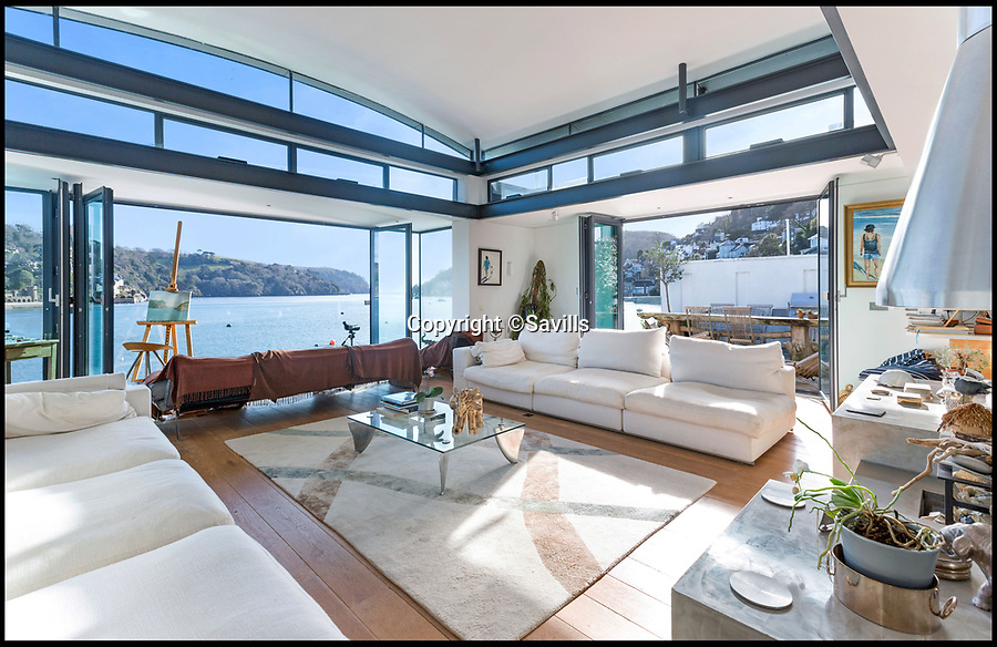 BNPS.co.uk (01202 558833)<br /> Pic: Savills/BNPS<br /> <br /> Let their be light...<br /> <br /> An award-winning waterfront home that has spectacular seaside views has gone on the market for £5m.<br /> <br /> The aptly named River House sits right on the Dart Estuary in Devon and has been so cleverly designed there is a glass floor in the master bedroom that looks down on the water.<br /> <br /> Its main living areas have floor-to-ceiling bi-fold doors and glass Juliet balconies to give the property a feel of Venice rather than Devon.<br /> <br /> Interestingly, the five bedroom house is being sold along with a nearby two bedroom town house that is owned by the same vendors.
