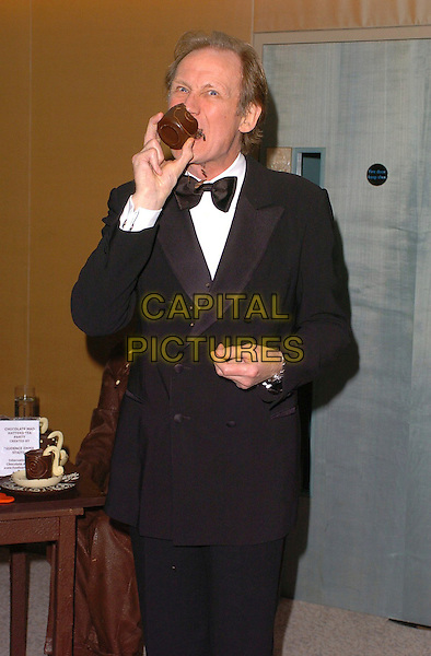 BILL NIGHY.The Chocolate Ball,.The Dorchester, London, England, .March 24th 2006..half length funny eating.Ref: CAN.www.capitalpictures.com.sales@capitalpictures.com.©Capital Pictures