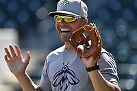 Pitching coach Joel Fuentes (12) of the Columbia Fireflies works out with his team before a game against the West Virginia Power on Friday, May 19, 2017, at Spirit Communications Park in Columbia, South Carolina. West Virginia won, 3-1. (Tom Priddy/Four Seam Images)