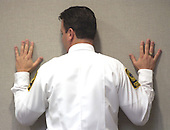 Prince William County (Virginia) Jail Supervisor, Roderick Osborne, demonstrates how he found convicted sniper John Allen Muhammad in a dayroom at the Prince William County jail during testimony in courtroom 10 at the Virginia Beach Circuit Court in Virginia Beach, Virginia on November 18, 2003. John Muhammad was convicted of capital murder on November 17, 2003 for his role as organizer of a two-man sniper team that killed 10 people and terrorized the Washington, D.C. area in 2002.  <br /> Credit: Dave Ellis - Pool via CNP