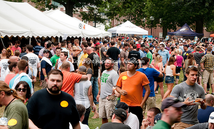 WATERBURY, CT 090614JS02--A large cross filled Library Park on Saturday afternoon for the annual Brass City Brew Fest 2014. The event was hosted this year by Nutmeg Fine Wines &amp; Spirits of Waterbury and was presented by, and for the benefit of Main Street Waterbury. <br /> Jim Shannon Republican-American