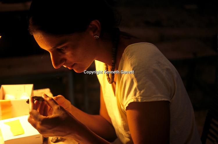 Urkesh, Hurrian Empire, Syria, 2400 BC, Sophie Bonetti examines an artifact