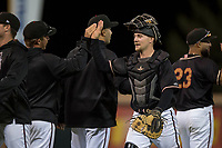 Modesto Nuts catcher Tyler Baker (17) high fives teammates after a California League game against the Lake Elsinore Storm at John Thurman Field on May 11, 2018 in Modesto, California. Modesto defeated Lake Elsinore 3-1. (Zachary Lucy/Four Seam Images)