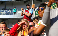 Burnley fans enjoy welcome the players and staff back to the pitch after the match<br /> <br /> Photographer Alex Dodd/CameraSport<br /> <br /> The Premier League - Burnley v Arsenal - Sunday 12th May 2019 - Turf Moor - Burnley<br /> <br /> World Copyright © 2019 CameraSport. All rights reserved. 43 Linden Ave. Countesthorpe. Leicester. England. LE8 5PG - Tel: +44 (0) 116 277 4147 - admin@camerasport.com - www.camerasport.com