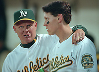 Oakland Athletics coach Mike Quade with Adam Piatt.<br />