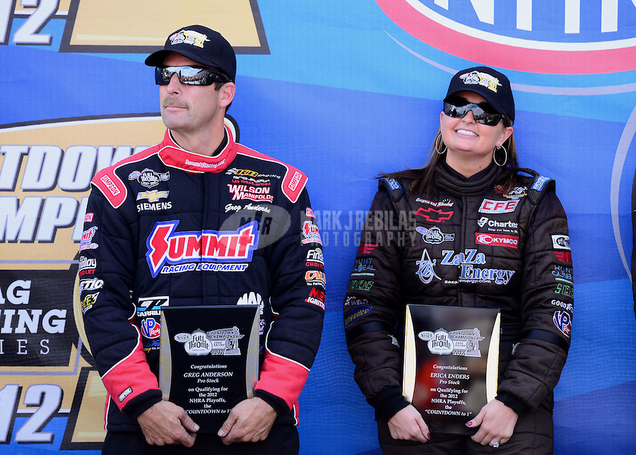 Sept. 14, 2012; Concord, NC, USA: NHRA pro stock driver Greg Anderson (left) and Erica Enders during qualifying for the O'Reilly Auto Parts Nationals at zMax Dragway. Mandatory Credit: Mark J. Rebilas-