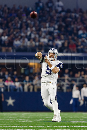 26.11.2015. Arlington, Texas, USA.  Dallas Cowboys Quarterback Tony Romo (9)rolls out for a pass during the NFL Thanksgiving game between the Carolina Panthers and the Dallas Cowboys played at AT&T Stadium in Arlington, TX.