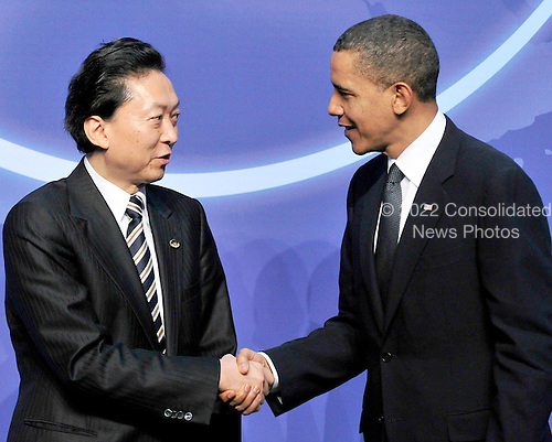 United States President Barack Obama welcomes Prime Minister Yukio Hatoyama of Japan to  the Nuclear Security Summit at the Washington Convention Center, Monday, April 12, 2010 in Washington, DC. .Credit: Ron Sachs / Pool via CNP