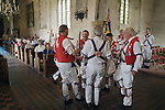 East Kent Morris Men dancing inside  the church of St Peter and St Paul Charing Kent UK. Spring Bank Holiday Monday. Rev Shelia Cox.