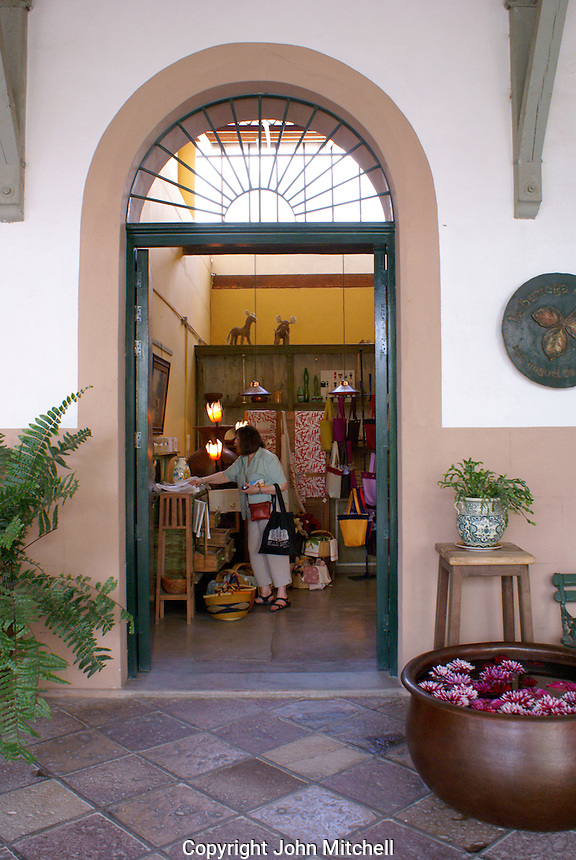 Female tourist shipping at  Fabrica La Aurora Art and Design Center, San Miguel de Allende, Mexico. San Miguel de Allende is a UNESCO World Heritage Site....