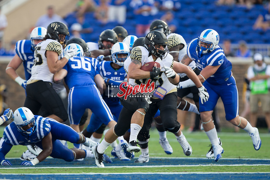 Cade Carney (36) of the Wake Forest Demon Deacons breaks through the line on his way to a 55-yard touchdown run during second half action against the Duke Blue Devils at Wallace Wade Stadium on September 10, 2016 in Raleigh, North Carolina.  The Demon Deacons defeated the Blue Devils 24-14.  (Brian Westerholt/Sports On Film)