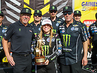 Mar 20, 2016; Gainesville, FL, USA; NHRA top fuel driver Brittany Force (center) celebrates with Alan Johnson (left) and crew chief Brian Husen after winning the Gatornationals at Auto Plus Raceway at Gainesville. Mandatory Credit: Mark J. Rebilas-USA TODAY Sports