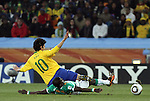 20 JUN 2010: Emmanuel Eboue (CIV) (below) and Kaka (BRA) (10). The Brazil National Team defeated the C'ote d'Ivoire National Team 3-1 at Soccer City Stadium in Johannesburg, South Africa in a 2010 FIFA World Cup Group G match.