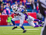19 October 2014: Buffalo Bills wide receiver Sammy Watkins breaks a tackle by Minnesota Vikings cornerback Josh Robinson in the second quarter at Ralph Wilson Stadium in Orchard Park, NY. The Bills defeated the Vikings 17-16 in a dramatic, last minute, comeback touchdown drive. Mandatory Credit: Ed Wolfstein Photo *** RAW (NEF) Image File Available ***