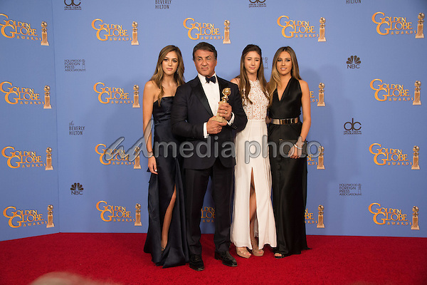 "After winning the category of BEST PERFORMANCE BY AN ACTOR IN A SUPPORTING ROLE IN A MOTION PICTURE for his work in ""Creed,"" actor Sylvester Stallone poses with his family backstage in the press room with his Golden Globe Award at the 73rd Annual Golden Globe Awards at the Beverly Hilton in Beverly Hills, CA on Sunday, January 10, 2016. Photo Credit: HFPA/AdMedia"