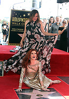 HOLLYWOOD, CA - OCTOBER 6: Mariska Hargitya and Debra Messing pictured as Debra Messing is Honored With A Star On The Walk Of Fame on Hollywood Boulevard in Hollywood, California on October 6, 2017. <br /> CAP/MPI/FS<br /> &copy;FS/MPI/Capital Pictures