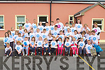 YOUNG VOLUNTEERS: The teachers and students of Derryquay NS giving their school a good clean as part of the National Day of Volunteers at Derryquay on Friday.