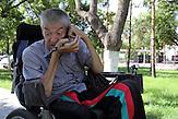 KAZ / Kasachstan / Pavlodar / 25.07.213 / Der querschnittgelähmte Georgij Tschetverikov in seinem Rollstuhl beim Telefonieren. Chetverikov ist nach einem Badeunfall querschnittsgelähmt / 61 years old tetraplegic Georgy Chetverikov in his electric wheelchair talking by telephone. He is handicapped after a swimming accident at the age of 18.