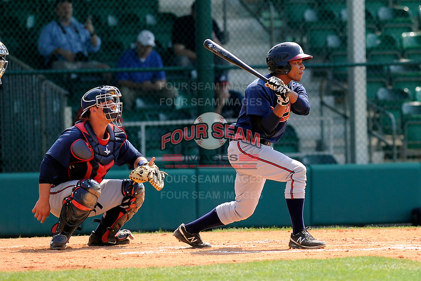 Infielder Gerald Chin (16) of the Atlanta Braves farm system in a Minor League Spring Training intrasquad game on Wednesday, March 18, 2015, at the ESPN Wide World of Sports Complex in Lake Buena Vista, Florida. The catcher is Tanner Murphy. (Tom Priddy/Four Seam Images)