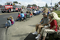 People watching fire trucks in parade at Silverdale, WA Whaling Days event. Stock photography by Olympic Photo Group
