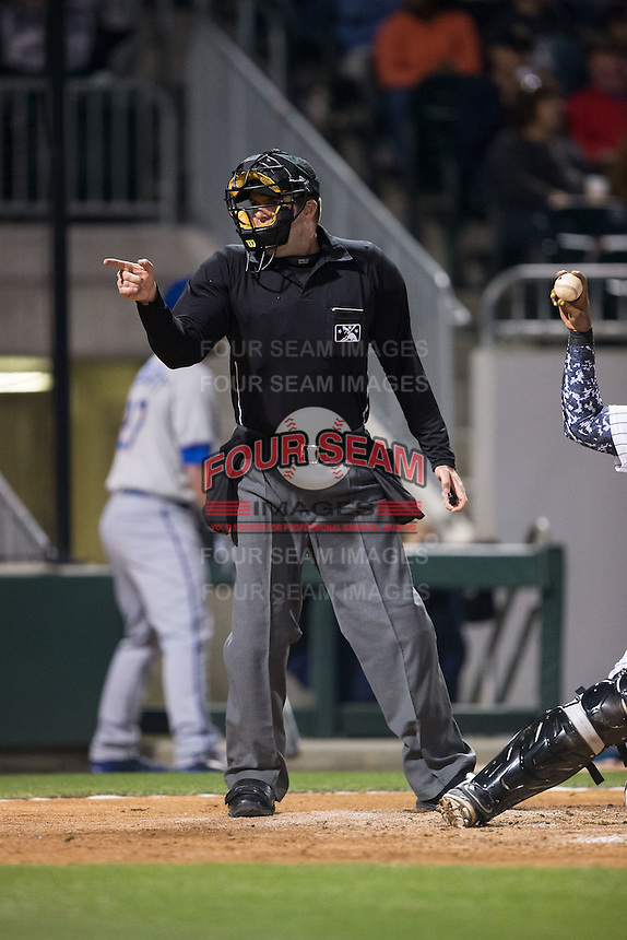 Home plate umpire John Bacon makes a strike call during the International League game between the Durham Bulls and the Charlotte Knights at BB&T BallPark on April 14, 2016 in Charlotte, North Carolina.  The Bulls defeated the Knights 2-0.  (Brian Westerholt/Four Seam Images)