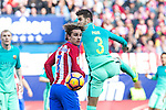 Antoine Griezmann of Atletico de Madrid competes for the ball with Gerard Pique of Futbol Club Barcelona during the match of Spanish La Liga between Atletico de Madrid and Futbol Club Barcelona at Vicente Calderon Stadium in Madrid, Spain. February 26, 2017. (Rodrigo Jimenez / ALTERPHOTOS)