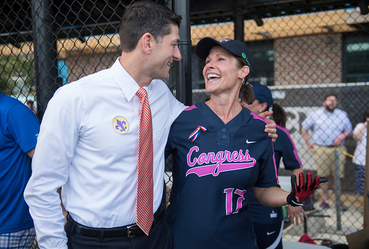 UNITED STATES - JUNE 21: Speaker of the House Paul Ryan, R-Wis., greets Rep. Cheri Bustos, D-Ill., before the Congressional Women's Softball game that pits Congresswomen against female journalists at Watkins Recreation Center on Capitol Hill, June 21, 2017. The game benefits the Young Survival Coalition that helps young women with breast cancer. The press team prevailed 2-1. (Photo By Tom Williams/CQ Roll Call)