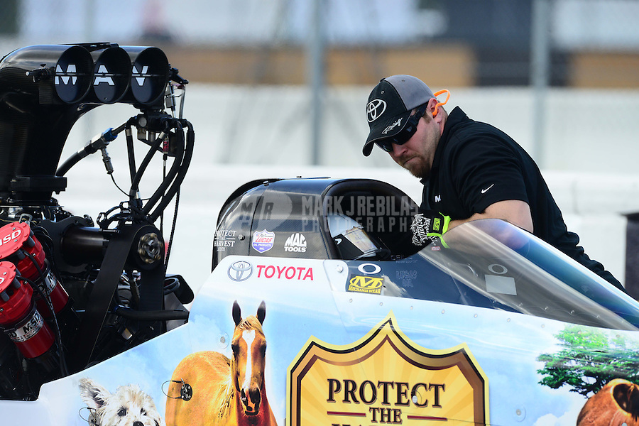 Jan. 16, 2013; Jupiter, FL, USA: A crew member works inside the car of NHRA top fuel dragster driver Brandon Bernstein during testing at the PRO Winter Warmup at Palm Beach International Raceway.  Mandatory Credit: Mark J. Rebilas-
