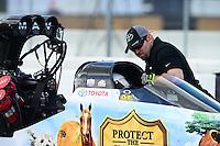 Jan. 16, 2013; Jupiter, FL, USA: A crew member works inside the car of NHRA top fuel dragster driver Brandon Bernstein during testing at the PRO Winter Warmup at Palm Beach International Raceway.  Mandatory Credit: Mark J. Rebilas-
