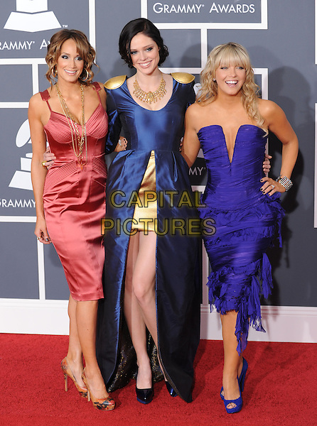 Coco Rocha,Cheryl Hickey & Kim D'eor.COCO ROCHA, CHERYL HICKEY & KIM D'EOR .Arrivals at the 52nd Annual GRAMMY Awards held at The Staples Center in Los Angeles, California, USA..January 31st, 2010.grammys full length pink blue purple strapless dress.CAP/RKE/DVS.©DVS/RockinExposures/Capital Pictures