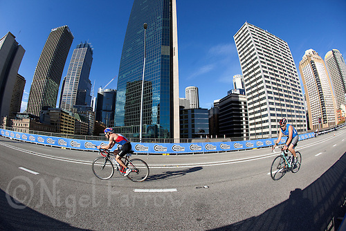 10 APR 2011 - SYDNEY, AUS - Competitors cycle along the Cahill Expressway during the ITU World Championship Series age group triathlon in Sydney, Australia  (PHOTO (C) NIGEL FARROW)