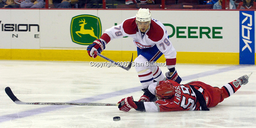 Montreal Canadiens' Andrei Markov (79) and the Carolina Hurricanes' Chad LaRose battle for a puck during their game Friday, Oct. 26, 2007 in Raleigh, NC. The Canadiens won 7-4.