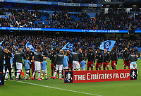 26th January 2020; Etihad Stadium, Manchester, Lancashire, England; English FA Cup Football, Manchester City versus Fulham; the Manchester City and Fulham players line up to shake hands prior to the kick off