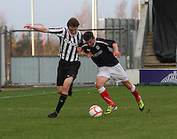 Jason Naismith and Kris Faulds challenge for the ball at the Falkirk v St Mirren  Scottish Football Association Youth Cup 4th Round match played at the Falkirk Stadium, Falkirk on 16.12.12. .