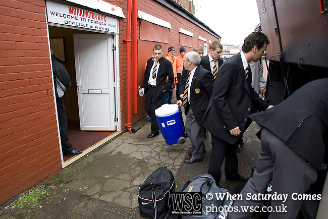 Workington AFC 0 Boston United 1, 24/02/2008. Borough Park, Blue Square North.  Players and officials of Boston United unloading kit from their team bus prior to the Blue Square North fixture between hosts Workington AFC (red) and Boston United at Borough Park. The visitors won with a solitary sixth-minute goal by Jon Rowan in front of 388 spectators. Both Workington AFC and Boston United were members of the Football League, the Cumbrians losing League status in 1977 while the Lincolnshire club were relegated in 2007 and demoted two divisions for financial irregularities. Photo by Colin McPherson.