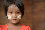 A girl in Tuingo, an ethnic Chin village in Myanmar. She has thanaka, a cosmetic paste, on her face.