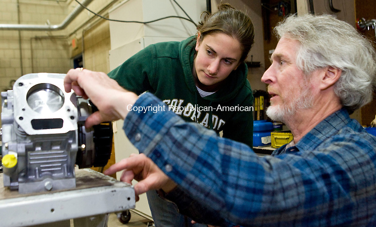 WOODBURY, CT - 03 MARCH 2009 -030309JT17-<br /> Nonnewaug senior Rachel Braverman and Tim Watko work on a small engine during a small engine maintenance class in the adult education program at Nonnewaug on Tuesday, March 3 in Woodbury.<br /> Josalee Thrift Republican-American