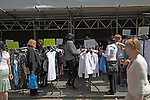 Women shopping for bargain clothes, street market, Leather Lane, London E4,