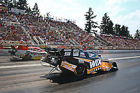 Aug. 2, 2014; Kent, WA, USA; NHRA funny car driver Tony Pedregon (near) races alongside brother Cruz Pedregon during qualifying for the Northwest Nationals at Pacific Raceways. Mandatory Credit: Mark J. Rebilas-