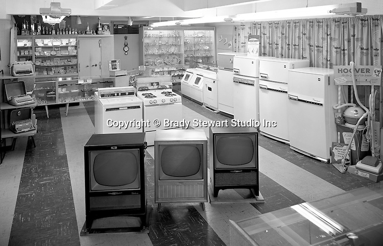 Client: Eiben and Irr Company<br /> Ad Agency:  Eiben and Irr Marketing<br /> Products: Department Store items<br /> Location: Wood Street and Liberty Avenue in Pittsburgh<br /> <br /> Location photography for Eiben and Irr's Holiday Catalog.  New Console Televisions and Kitchen Appliances on sale at Eiben and Irr Department Store.  Eiben and Irr Jewelry and Department Store operated in downtown Pittsburgh at the corner of Wood Street and Liberty Avenue from 1953-1979.