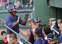 Infielder Elmer Reyes (7) of the Rome Braves is congratulated in the dugout after hitting a home run in a game against the Greenville Drive on May 6, 2012, at Fluor Field at the West End in Greenville, South Carolina. Greenville won, 11-3. (Tom Priddy/Four Seam Images).
