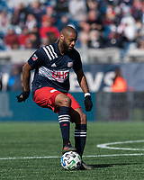 FOXBOROUGH, MA - MARCH 7: Andrew Farrell #2 of New England Revolution dribbles during a game between Chicago Fire and New England Revolution at Gillette Stadium on March 7, 2020 in Foxborough, Massachusetts.
