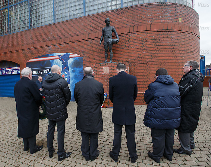 Rangers directors pay their tributes at the memorial statue at Ibrox Stadium