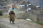 Dekchung Tamang walks through Gatlang, in the Rasuwa District of Nepal near the country's border with Tibet.<br /> <br /> In the aftermath of the April 2015 earthquake that ravaged Nepal, the ACT Alliance helped people in this village with a variety of services, including shelter and livelihood assistance.