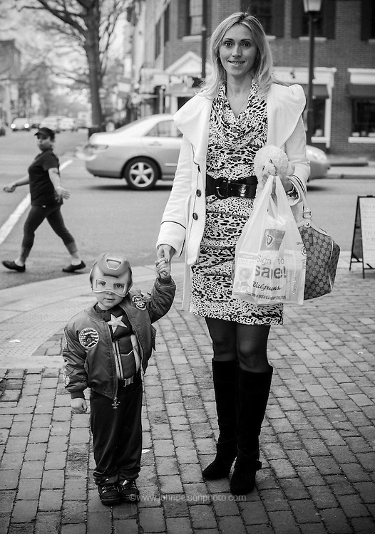 Olena Pastukh and her little super hero pause for a portrait on the streets of Old Town Alexandria, Virginia.