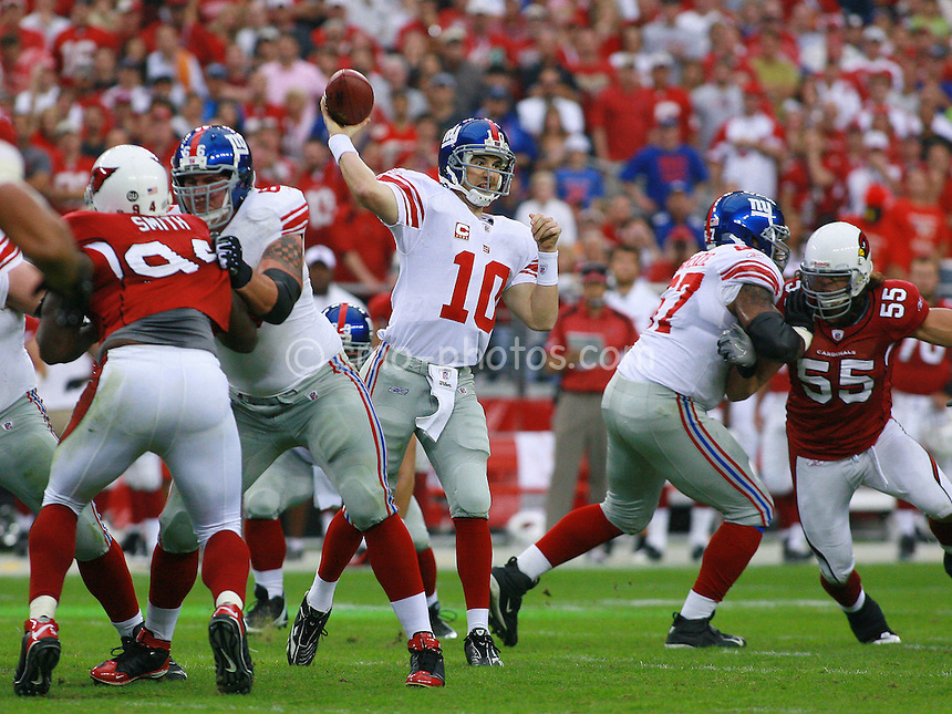 Nov 23, 2008; Glendale, AZ, USA; New York Giants quarterback Eli Manning (10) throws a pass in the second quarter of a game against the Arizona Cardinals at University of Phoenix Stadium.  Mandatory Credit: Chris Morrison-US PRESSWIRE