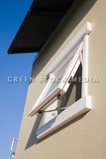 Dual paned glass window and James Hardie fiber cement siding helps insulating the house, maximizing energy efficiency. This home is Santa Clara University's team entry in Solar Decathlon 2007 (scusolar.org). Santa Clara, California, USA