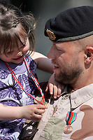 Capt. Erling Nervik with daughter Andrea. Norwegian soldiers receive medals after a tour with International Security Assistance Force (ISAF), Afghanistan. Prime Minister Jens Stoltenberg and Defense Minister Grete Faremo attended the ceremony held at Akershus Castle in Oslo.