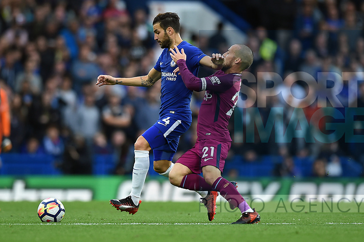 Cesc Fabregas of Chelsea is challenged by David Silva of Manchester City during the premier league match at the Stamford Bridge stadium, London. Picture date 30th September 2017. Picture credit should read: Robin Parker/Sportimage